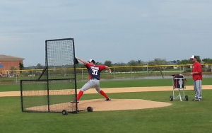 Stephen Strasburg delivers to the plate during live batting practice.