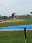 Nats prospect Felipe Rivero throws a pitch as pieces of Ian Desmond's splintered bat look on.