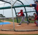 Bryce Harper takes a big cut but whiffs on a breaking ball during live batting practice.